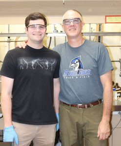 Etown professor and student posing for a photo in Musser lab.